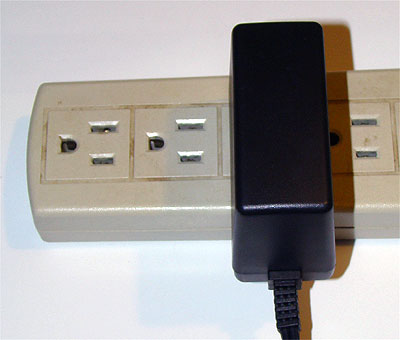 Thin style power brick doesn't block other power receptacles.