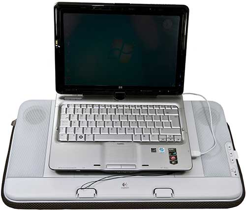 "HP tx2000 12.1"" convertible notebook sitting on top of the Logitech N700."