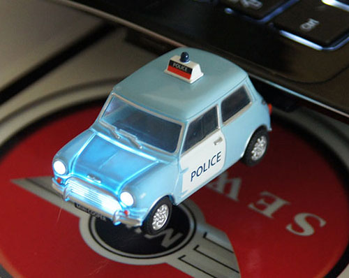 """Police Car"" Mini Cooper headlights turns on when plugged into a laptop's USB port."