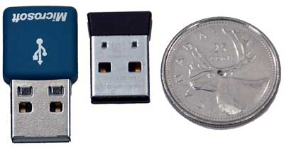 The mouse's wireless USB receiver (middle).