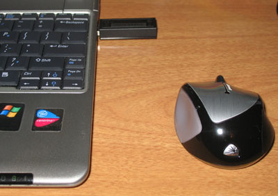 The wireless receiver will connect with the mouse from up to 30 feet away.